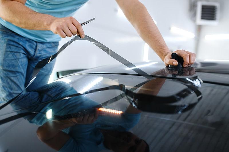 guy installing window tint