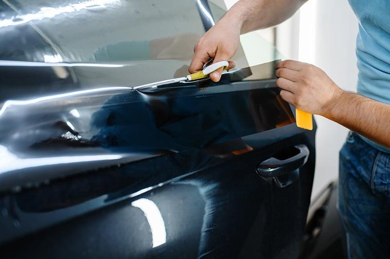 guy applying window tint