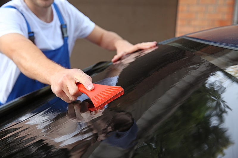 guy tinting car window