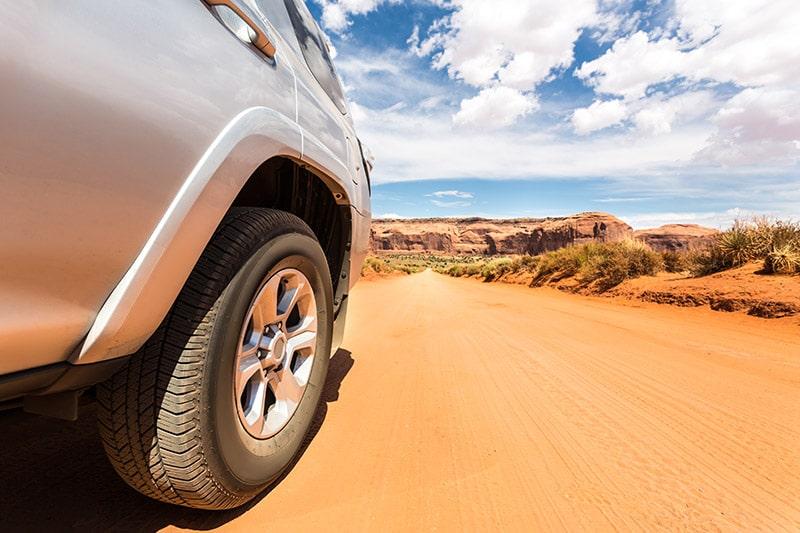 truck offroading in desert tire closeup